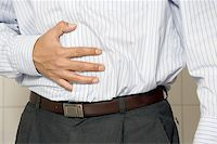 Closeup of a man having stomach pain or indigestion.  Stock Photo - Royalty-Freenull, Code: 400-04547424