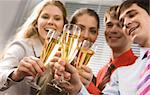 Photo of businesspeople cheering up their flutes filled with sparkling champagne Stock Photo - Royalty-Free, Artist: pressmaster                   , Code: 400-04550729
