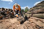 worker cutting logs with a chainsaw Stock Photo - Royalty-Free, Artist: spongecake                    , Code: 400-04555639