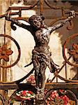 crucifixion sculpture ornament on the gate of a grave Stock Photo - Royalty-Free, Artist: jbouzou                       , Code: 400-04556312
