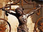 crucifixion sculpture ornament on the gate of a grave Stock Photo - Royalty-Free, Artist: jbouzou                       , Code: 400-04556313