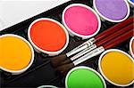 Water-color box with paint brushes on white background Stock Photo - Royalty-Free, Artist: mphoto                        , Code: 400-04556498
