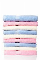 A multicolored towels stacked and reflected on white background Stock Photo - Royalty-Freenull, Code: 400-04557933