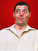 man portrait with many kisses on his face Stock Photo - Royalty-Freenull, Code: 400-04559676
