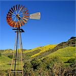 Windmill with a green and yellow spring field in the background. Stock Photo - Royalty-Free, Artist: hlehnerer                     , Code: 400-04561443