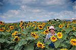 farmer standing in  a sunflower field Stock Photo - Royalty-Free, Artist: Noam                          , Code: 400-04565184