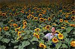 farmer standing in front of a sunflower field Stock Photo - Royalty-Free, Artist: Noam                          , Code: 400-04565185