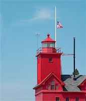 flag at half mast - American flag flying at half mast on a lighthouse. Stock Photo - Royalty-Freenull, Code: 400-04567805