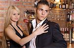 blond girl and a boy near the bar drinking a cocktail focus on the boy Stock Photo - Royalty-Free, Artist: carlodapino                   , Code: 400-04571560