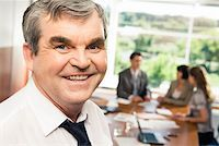 Photo of confident older chief smiling in the office Stock Photo - Royalty-Freenull, Code: 400-04573487