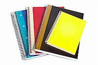 Some notebooks isolated on white background. Shallow depth of field Stock Photo - Royalty-Freenull, Code: 400-04574605