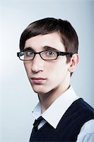 cute young guy with fashion haircut wearing glasses Stock Photo - Royalty-Freenull, Code: 400-04583647