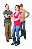 sad girls - Teenage girl rolling her eyes in front of angry parents Stock Photo - Royalty-Freenull, Code: 400-04587221