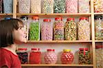young girl smiling at camera in sweet shop Stock Photo - Royalty-Free, Artist: gemphotography                , Code: 400-04589353