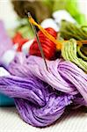 different color threads and needle on piece of  textile Stock Photo - Royalty-Free, Artist: AleksKo                       , Code: 400-04593362