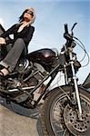 A beautiful blonde female sitting on a motorcycle.  Stock Photo - Royalty-Free, Artist: sumners                       , Code: 400-04593825