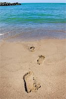 An image of footprints leading into the ocean Stock Photo - Royalty-Freenull, Code: 400-04595162
