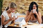 two friends having a good time in a cafe drinking a cup of tea Stock Photo - Royalty-Free, Artist: carlodapino                   , Code: 400-04595282