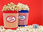 Two popcorn buckets over a red background. Stock Photo - Royalty-Free, Artist: AntonPrado                    , Code: 400-04598509