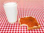 A glass of milk and a toast spread with jam, with a bite missing. Stock Photo - Royalty-Free, Artist: AntonPrado                    , Code: 400-04603075