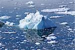 A small white/blue iceberg lying in the water in Ilulissat, Greenland Stock Photo - Royalty-Free, Artist: Imagix                        , Code: 400-04611256