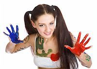 Beautiful girl, stained paint on a white background Stock Photo - Royalty-Freenull, Code: 400-04616893