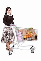 happy young woman with shopping cart Stock Photo - Royalty-Freenull, Code: 400-04620399