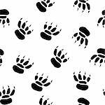 Abstract pawprint background. Seamless. Black-and-white palette. Vector illustration.