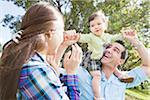 Family at Park Stock Photo - Premium Royalty-Free, Artist: Kevin Dodge, Code: 600-04625280