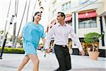 Couple Walking Outdoors Stock Photo - Premium Royalty-Free, Artist: Kevin Dodge, Code: 600-04625300