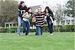 Family Playing Football Stock Photo - Premium Rights-Managed, Artist: Kevin Dodge, Code: 700-04625379