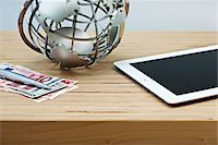 Desk with Currency, Globe and Tablet Computer Stock Photo - Premium Royalty-Freenull, Code: 600-04625580
