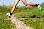 Running in nature. Freeze action closeup of running shoes and legs in action on trail. Stock Photo - Royalty-Free, Artist: Maridav                       , Code: 400-04629619