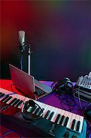 Microphone in the night colorful light in a recording studio Stock Photo - Royalty-Freenull, Code: 400-04630784