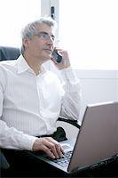 businessman working laptop computer, senior gray hair talking phone Stock Photo - Royalty-Freenull, Code: 400-04630793