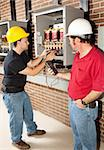 Technical school student learning how to repair industrial power distribution center with the help of an instructor. Stock Photo - Royalty-Free, Artist: lisafx                        , Code: 400-04631500