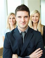 Portrait of three young business people with folded arms Stock Photo - Royalty-Freenull, Code: 400-04638993