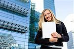 Blonde business woman posing in front of a modern blue office building Stock Photo - Royalty-Free, Artist: hfng                          , Code: 400-04640670