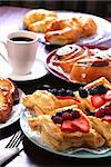 Plates of assorted pastries with coffee at cafe Stock Photo - Royalty-Free, Artist: karimala                      , Code: 400-04651043