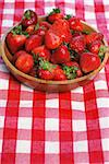 Wooden bowl of fresh strawberries on picnic table Stock Photo - Royalty-Free, Artist: karimala                      , Code: 400-04651059