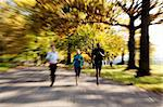 Three people jogging in the park with zoom blur Stock Photo - Royalty-Free, Artist: Leaf                          , Code: 400-04653601