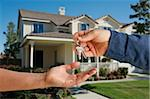 Handing Over the House Keys in Front of a Beautiful New Home. Stock Photo - Royalty-Free, Artist: Feverpitched                  , Code: 400-04653868