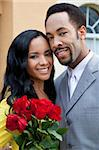 A romantic and happy African American man and woman couple in their thirties smiling together with a bunch of roses. Stock Photo - Royalty-Free, Artist: darrenbaker, Code: 400-04655736