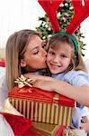 Loving mother kisses daughter at Christmas in the living-room Stock Photo - Royalty-Free, Artist: 4774344sean                   , Code: 400-04660029