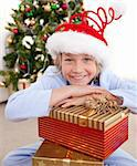 Happy little boy sitting on the floor with Christmas presents Stock Photo - Royalty-Free, Artist: 4774344sean                   , Code: 400-04660033