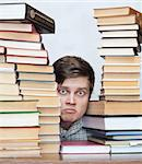 Young crazy discontent student between books Stock Photo - Royalty-Free, Artist: BooblGum                      , Code: 400-04672135