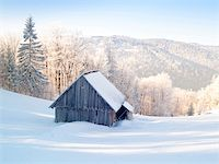 Abandoned wooden cottage in mountain under snow. Winter time. Stock Photo - Royalty-Freenull, Code: 400-04672774