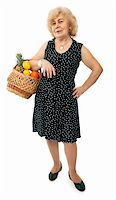 happy elderly woman with basket of fruits isolated on white background Stock Photo - Royalty-Freenull, Code: 400-04676008