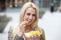 Pretty blond girl eating fries with mayonnaise Stock Photo - Royalty-Freenull, Code: 400-04683479