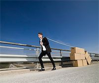 Man with Moving Boxes outdoor Stock Photo - Royalty-Free, Artist: gemenacom, Code: 400-04684565
